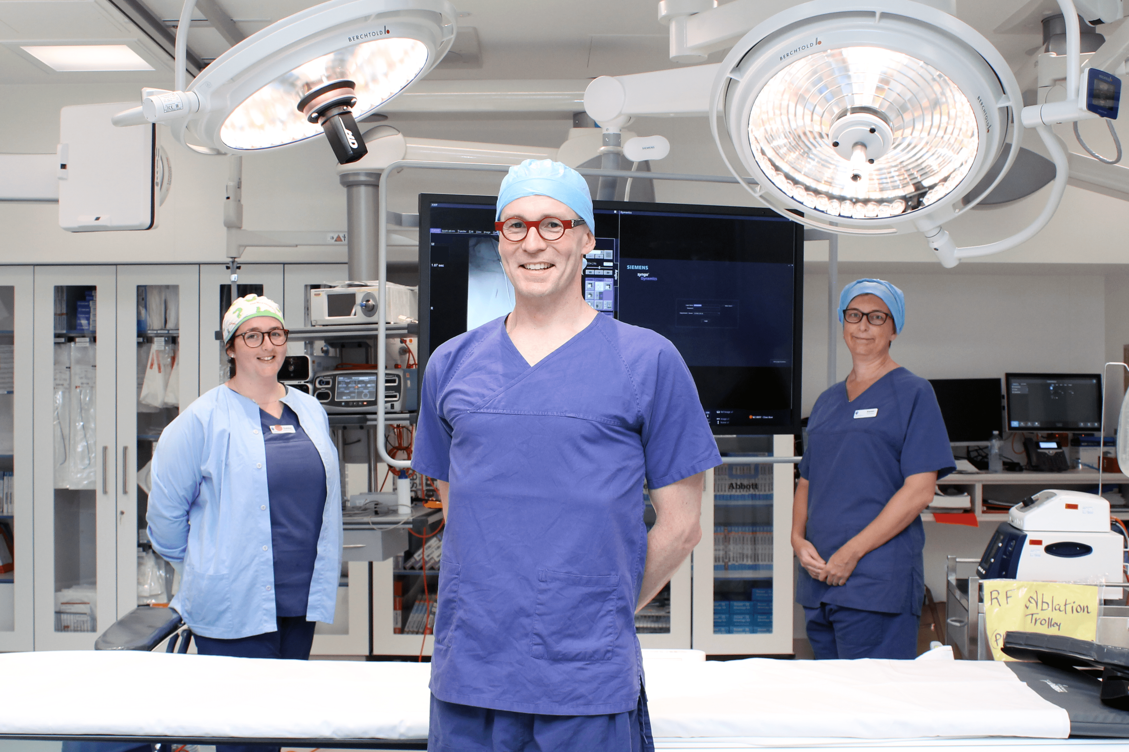 Dr Simon Quinn in hybrid operating theatre with theatre nurses